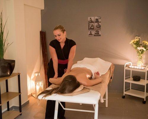 A woman enjoying a massage.