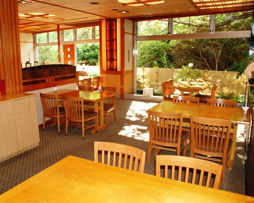 An indoor restaurant with outside view.