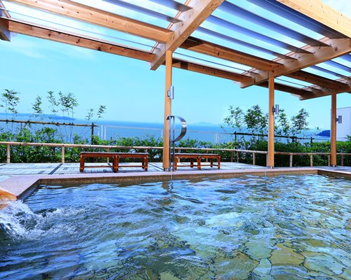 An outdoor swimming pool and bay view.
