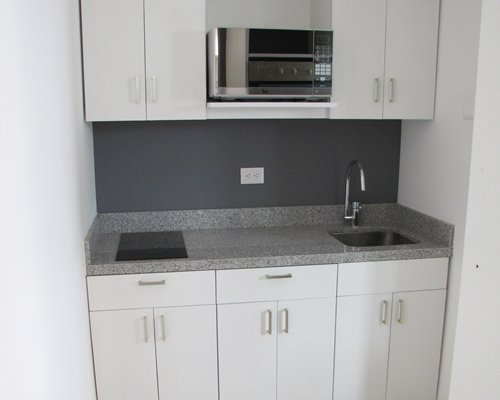 Kitchenette with microwave.