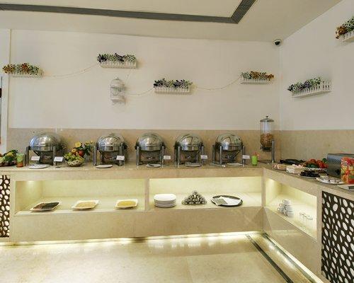 An indoor restaurant with buffet area.