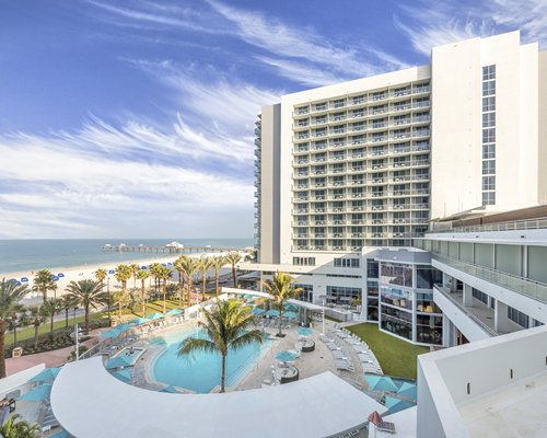 Wyndham Clearwater Beach Resort with an outdoor swimming pool alongside the ocean.