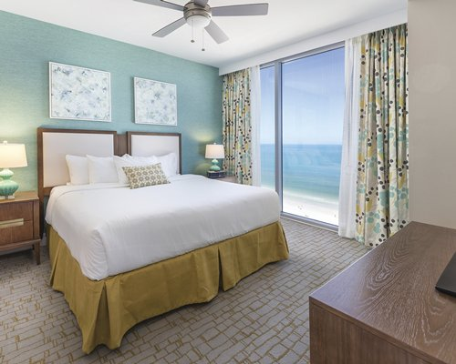 A well furnished bedroom with ocean view.