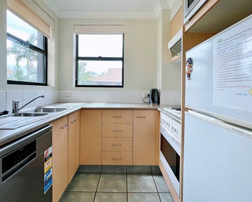 A balcony with table and chairs and view.